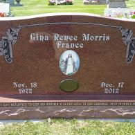 Serpentine top monument with custom inlaid color etched tile and covered porcelain photo.